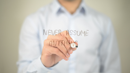 Never Assume Anything , man writing on transparent screen