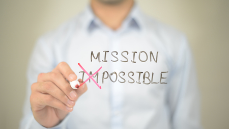 Mission Possible,  Man writing on transparent screen Stock Photo