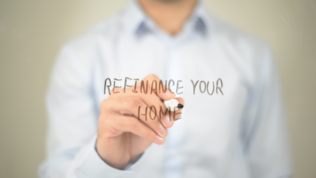 Refinance Your Home, Man Writing on Transparent Screen Stock Photo