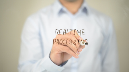 Realtime Processing, Man Writing on Transparent Screen Stock Photo
