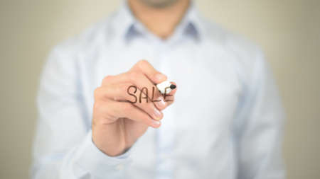 Sale,  Man writing on transparent screen Stock Photo