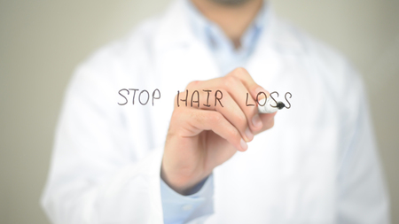 Stop Hair Loss , Doctor writing on transparent screen