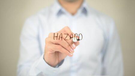 Hazard , Man writing on transparent screen