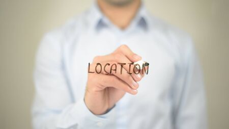 drawing pin: Location,  Man writing on transparent screen Stock Photo