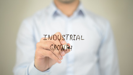 Industrial Growth, man writing on transparent screen Stock Photo