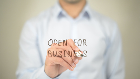 Open for Business,  Man writing on transparent screen