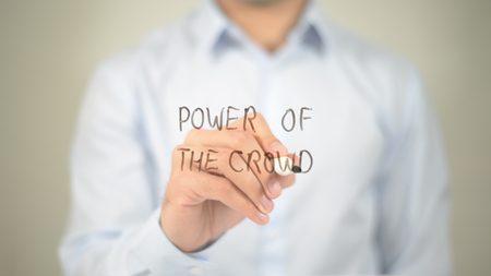 Power Of The Crowd , man writing on transparent screen Stock Photo