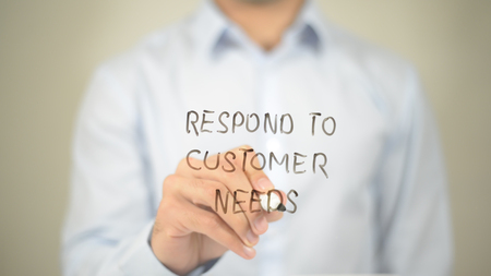 customer facing: Respond to Customer Need, man writing on transparent screen Stock Photo