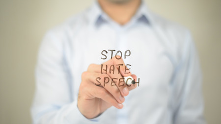 Stop Hate Speech , man writing on transparent screen