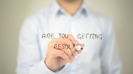Are You Getting Results ? , man writing on transparent screen Stock Photo