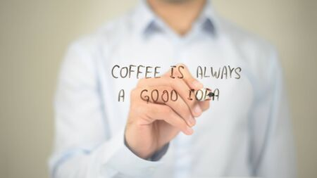 Coffee is Always a Good Idea, Man writing on transparent screen Stock Photo