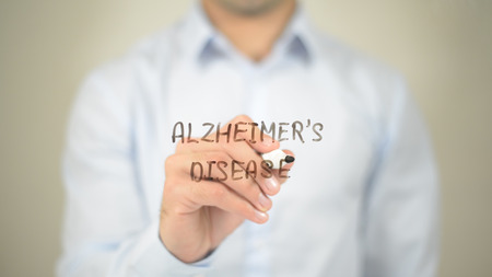 Alzheimers Disease,  Man writing on transparent screen