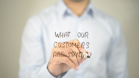 What Our Customers Are Saying ? , man writing on transparent screen Standard-Bild