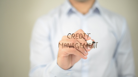 Credit Management , man writing on transparent screen Stock Photo