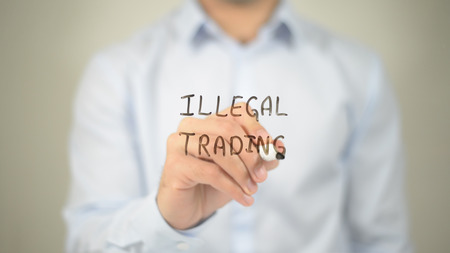 Illegal Trading , man writing on transparent screen