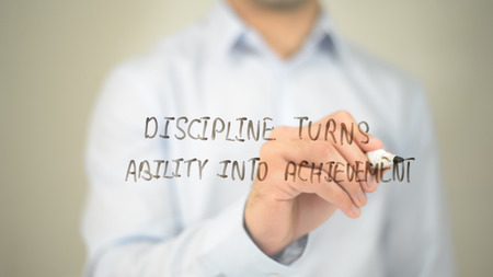 questions: Discipline Turns Ability into Achievement, man writing on transparent screen