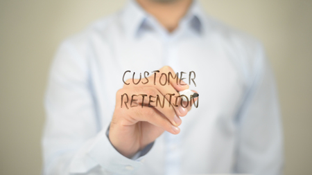 Customer Retention, man writing on transparent screen