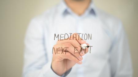 Mediation Next Exit, man writing on transparent screen