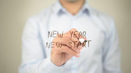 New Year New Start  , man writing on transparent screen