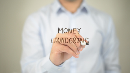 Money Laundring , man writing on transparent screen
