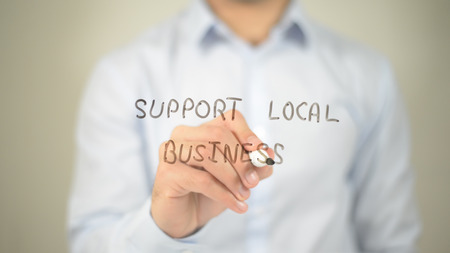 retailer: Support Local Business , man writing on transparent screen Stock Photo