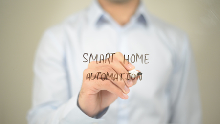 Smart Home Automation, Man Writing on Transparent Screen Stock Photo