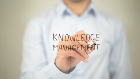 Knowledge Management   ,  man writing on transparent wall