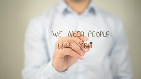 We Need people Like you, man writing on transparent screen Stock Photo - 85829253