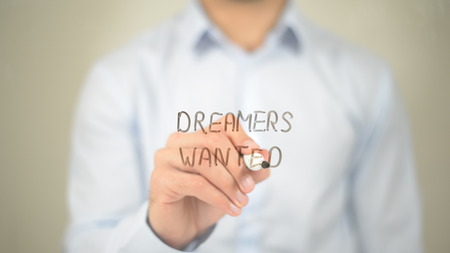 Dreamers Wanted, Man writing on transparent screen