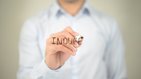 Induce, man writing on transparent screen Stock Photo
