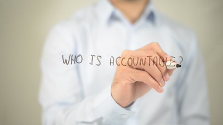 Who Is Accountable , man writing on transparent screen Stock Photo