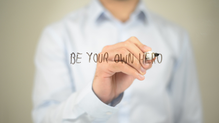 Be Your Own Hero, Man writing on transparent screen Stock Photo