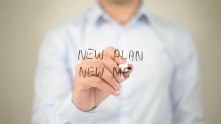 New Plan New Me, man writing on transparent screen