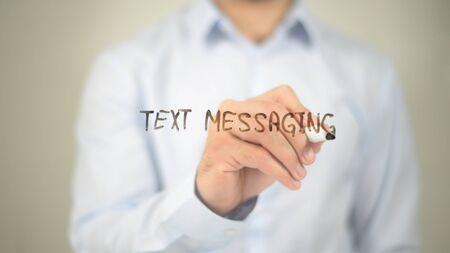 Text Messaging, man writing on transparent screen