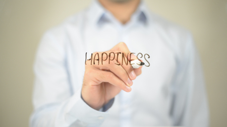 Happiness , Man writing on transparent screen Stock Photo