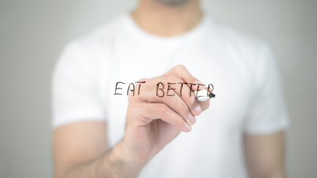 Eat Better, man writing on transparent screen Stock Photo