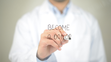 Become A Donor, Doctor writing on transparent screen