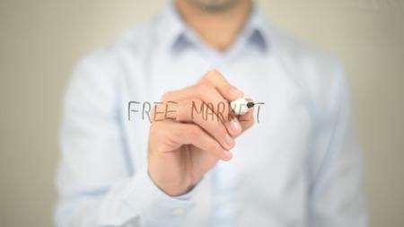 Free Market , man writing on transparent screen