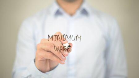 Minimum wage   ,  man writing on transparent wall