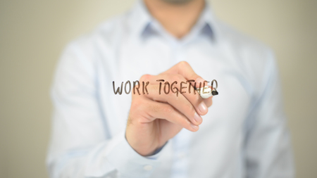 Work Together,  Man writing on transparent screen Stock Photo
