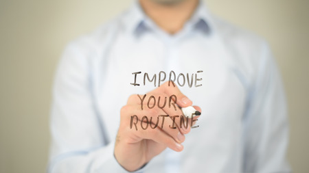 Improve Your Routine , man writing on transparent screen