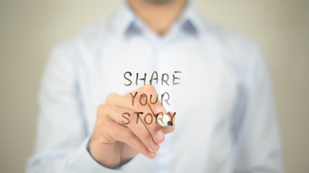 Share Your Story   ,  man writing on transparent wall Stock Photo