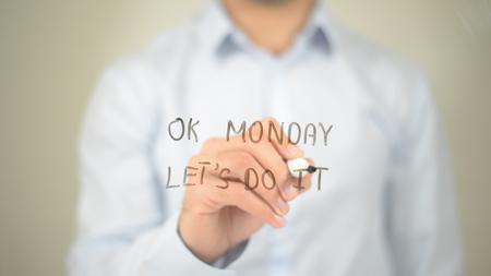 Ok Monday Lets Do it , Man writing on transparent screen Фото со стока