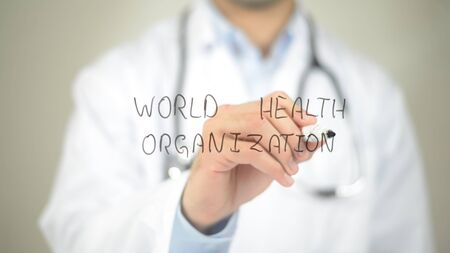 World Health Orgaization , Doctor writing on transparent screen