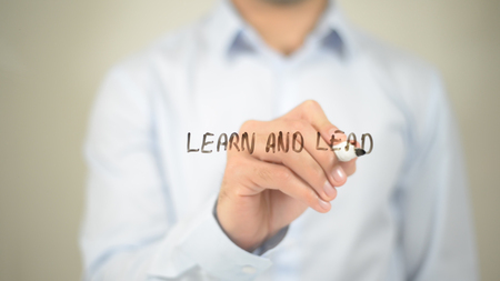 Learn And Lead , writing on transparent wall Stock Photo