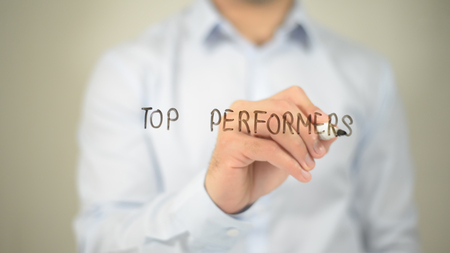 Top Performers , man writing on transparent screen Stock Photo