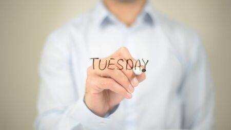 Tuesday, Man Writing on Transparent Screen