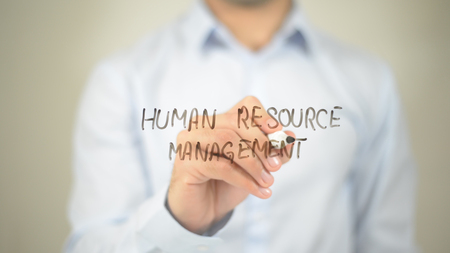 HRM ( human resource management )   ,  man writing on transparent wall Stock Photo