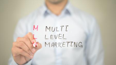 MLM, Multi Level Marketing,  Man writing on transparent screen