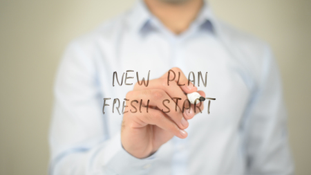 New Plan Fresh Start, man writing on transparent screen